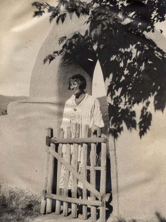 Mabel Dodge Luhan standing in gateway