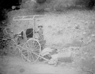 Photo by Phillips of Blumenschein with the broken wheel, September 1898. Courtesy Taos Historic Museums.