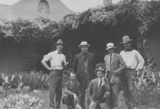 PHOTO CREDIT: The six founding members of the Taos Society of Artists in Virginia Walker Couse's garden, 1915 (L-R, E.L. Blumenschein, O.E. Berninghaus, E.I. Couse, J.H. Sharp, B.G. Phillips, and W.H. Dunton) Photo credit: The Couse-Sharp Historic Site, Taos, NM